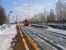 Locomotive on the snowy railway Stock Photography