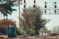 Locomotive staying on red light on a left side of rail road stock photo
