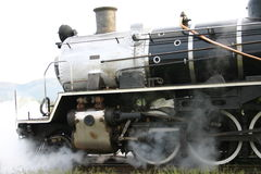 Locomotive steam. Old steam Locomotive blowing out steam stock photo