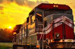 Locomotive at sunset. Sunset behind red and gray locomotive Stock Image