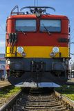 Train locomotive. Front of a colored red and yellow train locomotive, waiting to pull the train with tourists royalty free stock photos