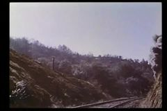 Locomotive traveling through mountains stock video