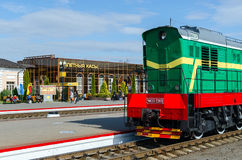 Locomotive on the ways of train station in Mogilev, Belarus. MOGILEV, BELARUS - APRIL 25, 2015: Unidentified people are waiting to board in trains on the stock photography