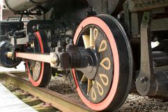 Locomotive wheel. S viewed from close to the ground.  wheels are painted white decorative pattern, tracks are in view Stock Photos