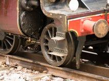 Locomotive wheel. A close up of a retro locomotive wheel on rails stock photo