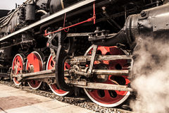 Locomotive wheels with clouds of steam Stock Photos