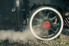 Locomotive wheels with clouds of steam Royalty Free Stock Images