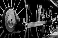 Locomotive Wheels. The large driving wheels of a steam locomotive in monochrome close-up Royalty Free Stock Images