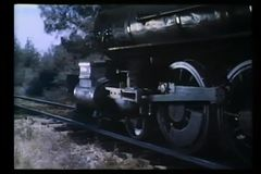 Locomotive wheels traveling down railroad track stock video