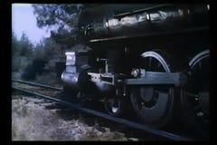 Locomotive wheels traveling down railroad track stock video