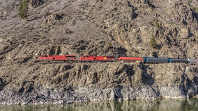 Locomotives Pulling a lng Train through the Fraser Canyon Stock Image