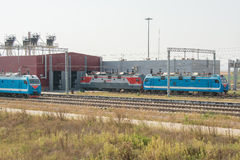 Locomotives trains stand at the gate of the locomotive depot Royalty Free Stock Photography
