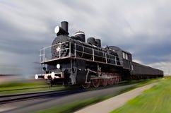 Locomotora de vapor en el movimiento Imágenes de archivo libres de regalías