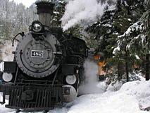 Locomotora de vapor en nieve Fotos de archivo libres de regalías
