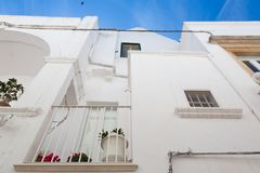 LOCOROTONDO. Puglia, Italy - View of the little picturesque village in south Italy. The white color of its houses represents the background of its baroque Royalty Free Stock Photo