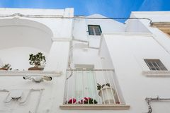 LOCOROTONDO. Puglia, Italy - View of the little picturesque village in south Italy. The white color of its houses represents the background of its baroque Stock Photography