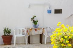 LOCOROTONDO. Puglia, Italy - View of the picturesque little village in south Italy; detail of walls and doors with their colorful flowers Royalty Free Stock Images