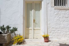 LOCOROTONDO. Puglia, Italy - View of the picturesque little village in south Italy; detail of walls and doors with their colorful flowers Stock Photography