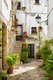 LOCOROTONDO. Puglia, Italy - View of the picturesque little village in south Italy, with its balconies decorated with colorful geraniums Stock Image