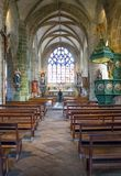 Landscapes and architectures of Brittany. Locronan, France - August 10, 2017: Statues of Saints in the nave of the St Ronan church Stock Photo