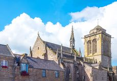 Landscapes and architectures of Brittany. Locronan, France, back view of the St Ronan church and bell tower Stock Image