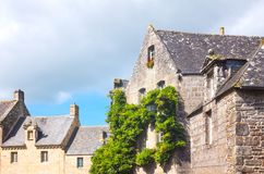 Landscapes and architectures of Brittany. Locronan, France, view of the traditional medieval houses in Eglise square Royalty Free Stock Images