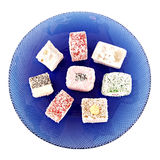 Locum plate. Turkish Delight in blue plate on white Royalty Free Stock Photography