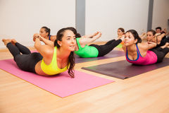Locust pose in a yoga studio Royalty Free Stock Photos