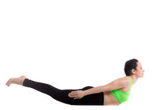 Locust yoga Pose. Beautiful slim girl doing pilates workout, yoga asana Salabhasana, Locust, Grasshopper Pose, stretching exercise for back, performing Double Stock Image