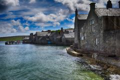 Lodberries. Buildings with entrances built into the sea at the south end of the old town in Lerwick, Shetland Stock Photos