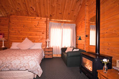 Lodge bedroom interior with fireplace Royalty Free Stock Images