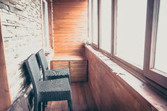 Lodge interior in vintage rustic style decorated with wood planks and stone with big windows bar counter and bar chairs Royalty Free Stock Photo