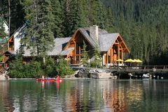 Lodge on a lake. A wooden lodge on a lake shore Stock Photos