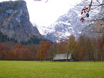 Lodge beside mountain in Germany. The little house between the meadow and the snow mountain Royalty Free Stock Photo