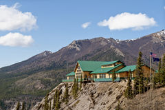 Lodge in mountains. Exterior of Grand Denali lodge with mountains in background, Denali National Park, Alaska, U.S.A Royalty Free Stock Images
