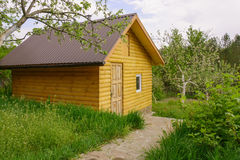 Lodge. Small wooden house surrounded by green gardens Stock Photo