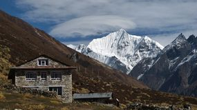 Lodge and snow capped Yala Peak. Scene in the Langtang valley, Nepal Royalty Free Stock Photography