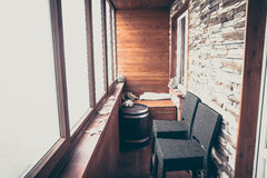 Lodge in vintage nautical style decorated with wood planks and stone with big windows bar counter and bar chairs in rustic style Stock Photos