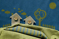 Lodges from a cardboard and buttons on blue fabric. A lodge in the village. Royalty Free Stock Images