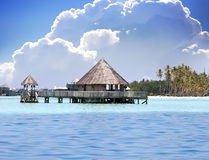 Lodges over transparent quiet sea water- tropical paradise, Royalty Free Stock Image