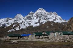 Lodges in Thagnak and snow capped Phari Lapcha Royalty Free Stock Photo