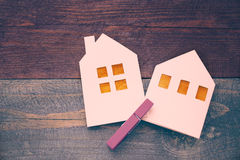 Lodges from white paper on a wooden background. Symbol of winter Stock Images