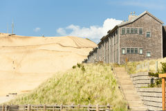Lodging at Pacific City with sand hill in background Royalty Free Stock Photos