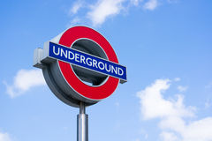 Lodnon Underground Roundel. London Underground roundel pictured against a blue sky background Royalty Free Stock Images