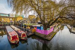 Lodon, England - The world famous Camden Lock Market with mooring houseboats. And tree Stock Image