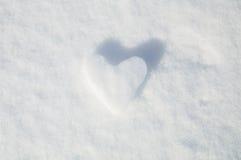 Lodowy serce na śnieżnym tle Fotografia Stock