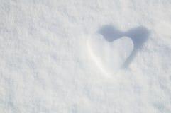 Lodowy serce na śnieżnym tle Zdjęcia Stock