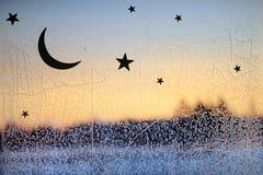 Lodowy wzór i światło słoneczne na zimy szkle zdjęcia royalty free