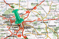 Lodz. Poland, Europe. Push pin on an old map showing travel destination. Selective focus Stock Image
