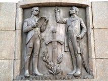 Lodz, Polen Een bas-hulp met het beeld van Tadeusz Kosciusko die de eed reciteren Fragment van een monument van Kosciusko royalty-vrije stock foto's